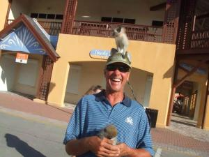 Here is a picture of my brother with a monkey on his head some place in the South Pacific.